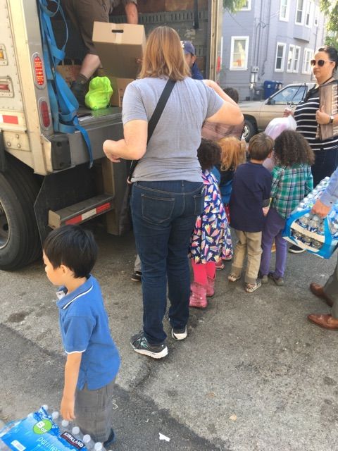 Students and parents helping to load the truck at Maya Lin School.
